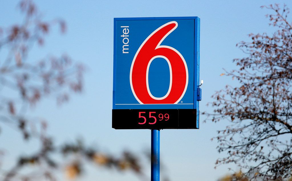 FILE - This Jan. 3, 2018 file photo shows a Motel 6 in SeaTac, Wash. he national chain Motel 6 agreed Thursday, April 4, 2019, to pay $12 million to settle a lawsuit filed by Washington state claiming names of hotel guests were provided to immigration officials for two years, according to Attorney General Bob Ferguson. (AP Photo/Elaine Thompson, File)