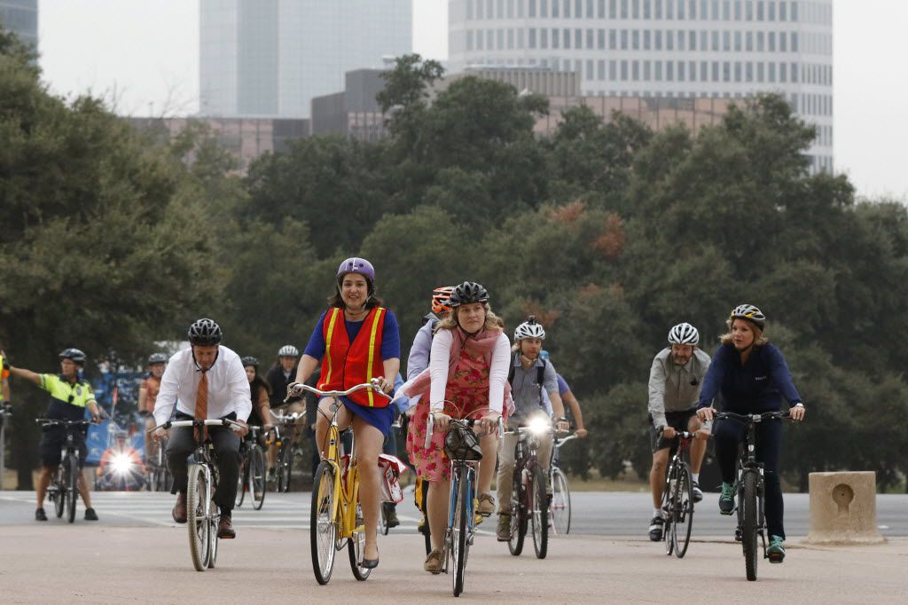 Catherine Cuellar, in the orange-and-yellow vest, rode her bike to City Council in October 2015 with other Dallas residents and City Council members.