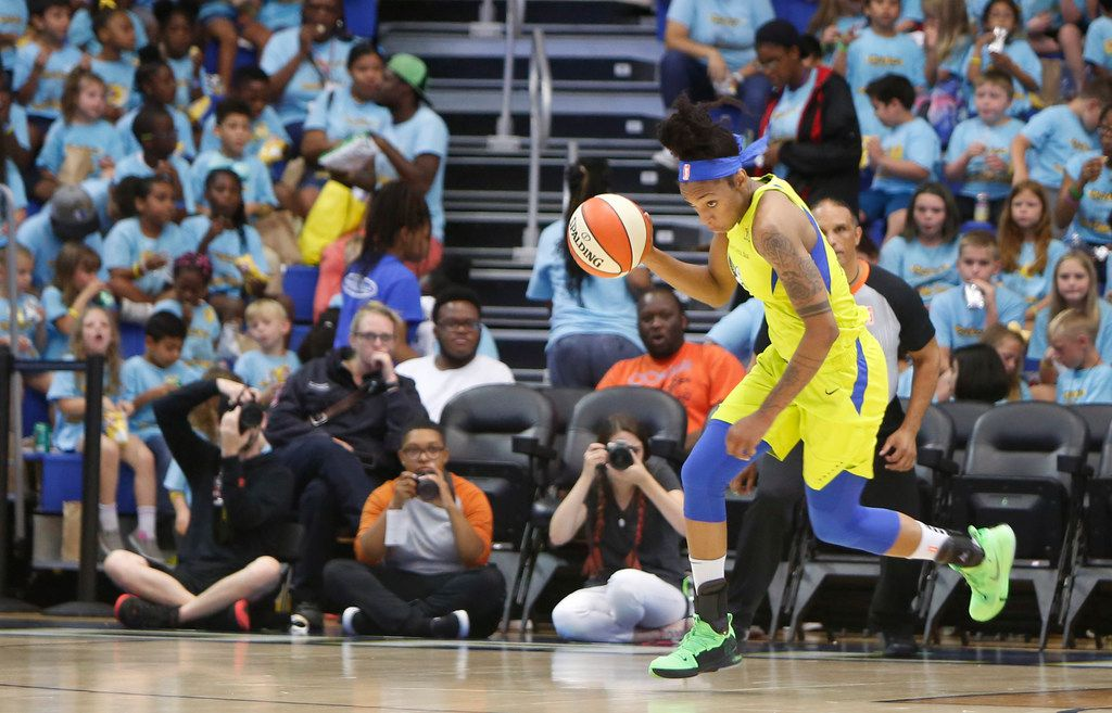 Dallas Wings forward Glory Johnson (25) dribbles with authority as she sets up an offensive play after gathering a defensive rebound during first half action against the Los Angeles Sparks. The Wings defeated the Sparks, 74-62. The two teams played their WNBA game at College Park Center in Arlington on July 9, 2019.  (Steve Hamm/ Special Contributor)