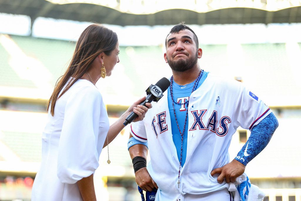 ARLINGTON, TX - JUNE 17: Jose Trevino #71 of the Texas Rangers is interviewed by Fox Sports Southwest reporter Emily Jones after he walks it off with a two-run single in the ninth against the Colorado Rockies at Globe Life Park in Arlington on Father's Day, June 17, 2018 in Arlington, TX. The Texas Rangers defeated the Colorado Rockies, 13-12.