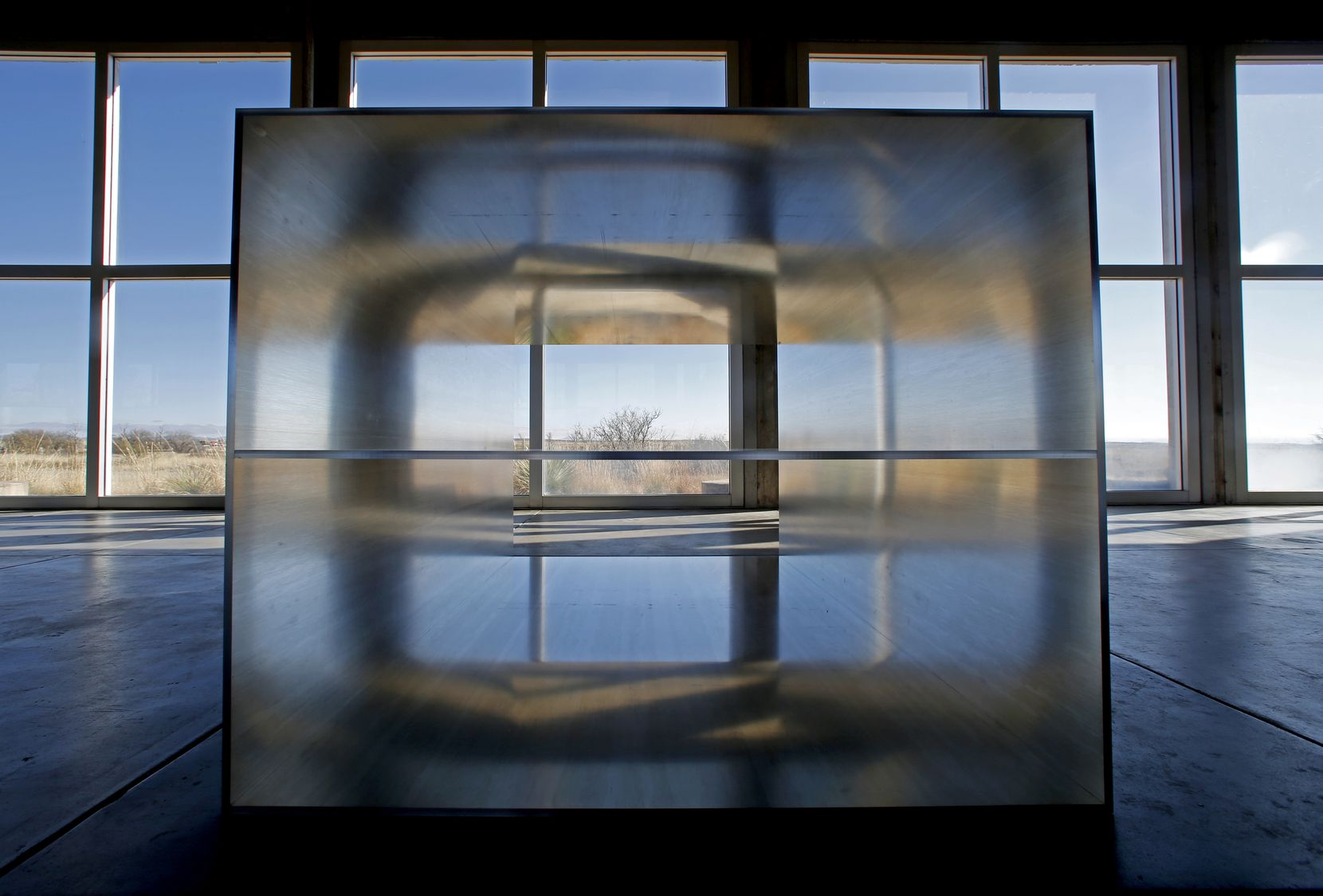 The southwest Texas landscape is seen through one of the pieces in Donald Judd's 100 untitled works in mill aluminum, 1982-1986, at the Chinati Foundation. (Guy Reynolds/The Dallas Morning News, © 2017 Judd Foundation/Artists Rights Society (ARS), New York)