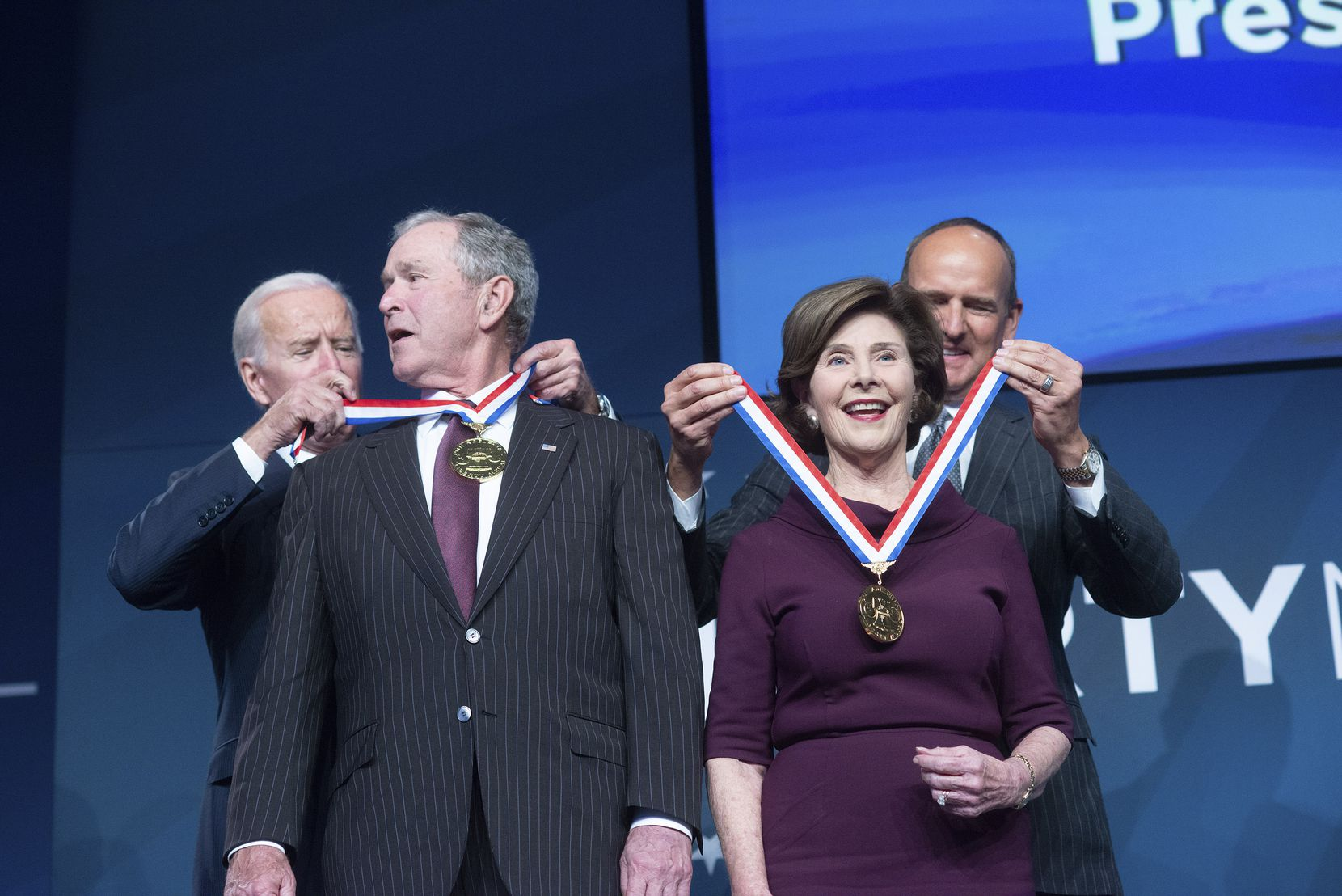 Former Vice President Joe Biden (back left) and National Constitution Center Executive Committee Chairman Doug DeVos present former President George W. Bush and former first lady Laura Bush the 2018 Liberty Medal in a Veterans Day ceremony at  The National Constitution Center Sunday in Philadelphia.