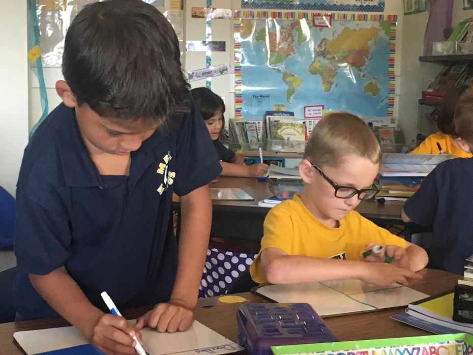 Alec Gonzalez and Corbin Kroeker are partners during a math exercise. They are enrolled in the dual-language program available to all second grade students in the El Paso Independent School District.