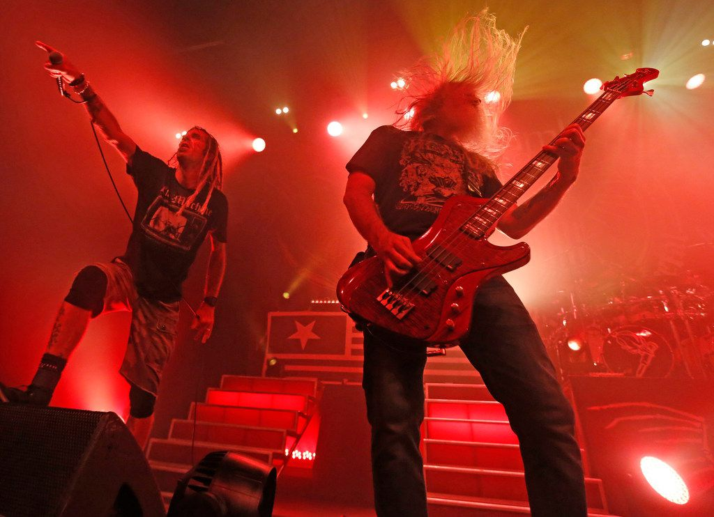 Lamb of God vocalist Randy Blythe and bassist John Campbell are pictured as the group performs in concert Tuesday at the Bomb Factory.