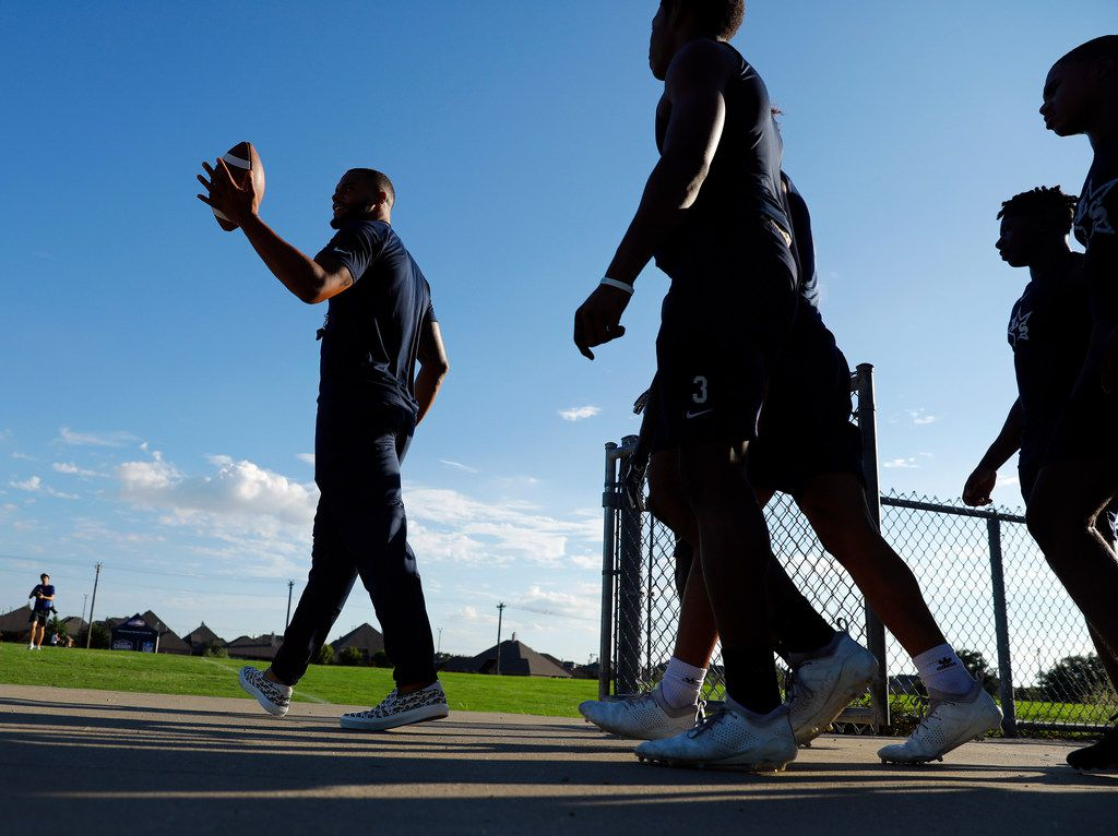 Dallas Cowboys quarterback Dak Prescott (left) joined Lone Star High School football players to film a Chunky Soup commercial at the schools practice field, Monday, September 17, 2018. (Tom Fox/The Dallas Morning News)