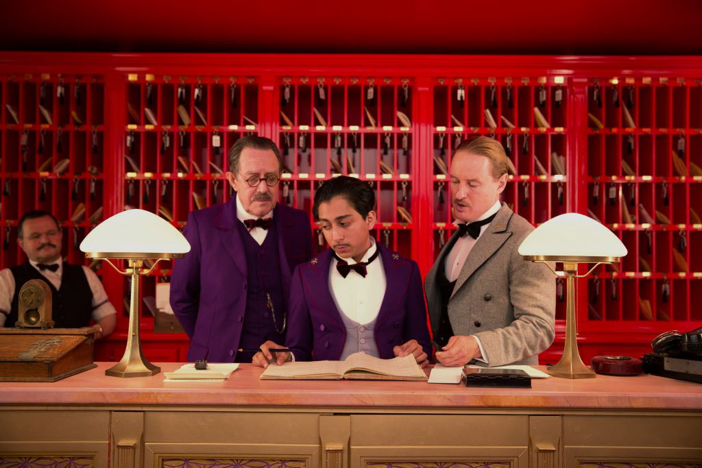 "Tom Wilkinson, Tony Revolori, center, and Owen Wilson, right,  in ""The Grand Budapest Hotel ."""