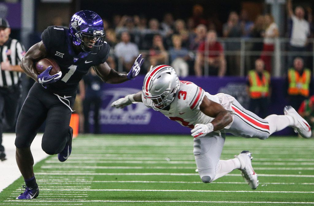 FILE - TCU wide receiver Jalen Reagor (1) makes a break past Ohio State cornerback Damon Arnette Jr. (3) during the AdvoCare Showdown between the Ohio State Buckeyes and the Texas Christian University Horned Frogs on Saturday, Sept. 15, 2018 at AT&T Stadium in Arlington, Texas. (Ryan Michalesko/The Dallas Morning News)