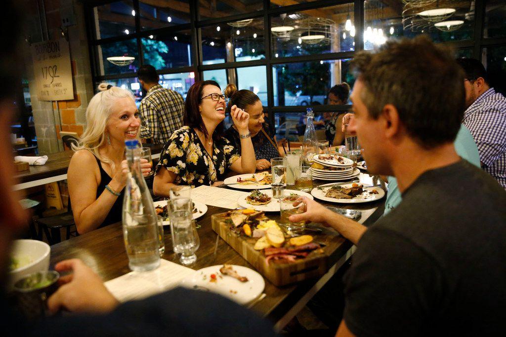 Kristin Thomas, (from left) Joy Noon and Tiffany Mitchell eat at Feed Company in Dallas on May 20, 2018.