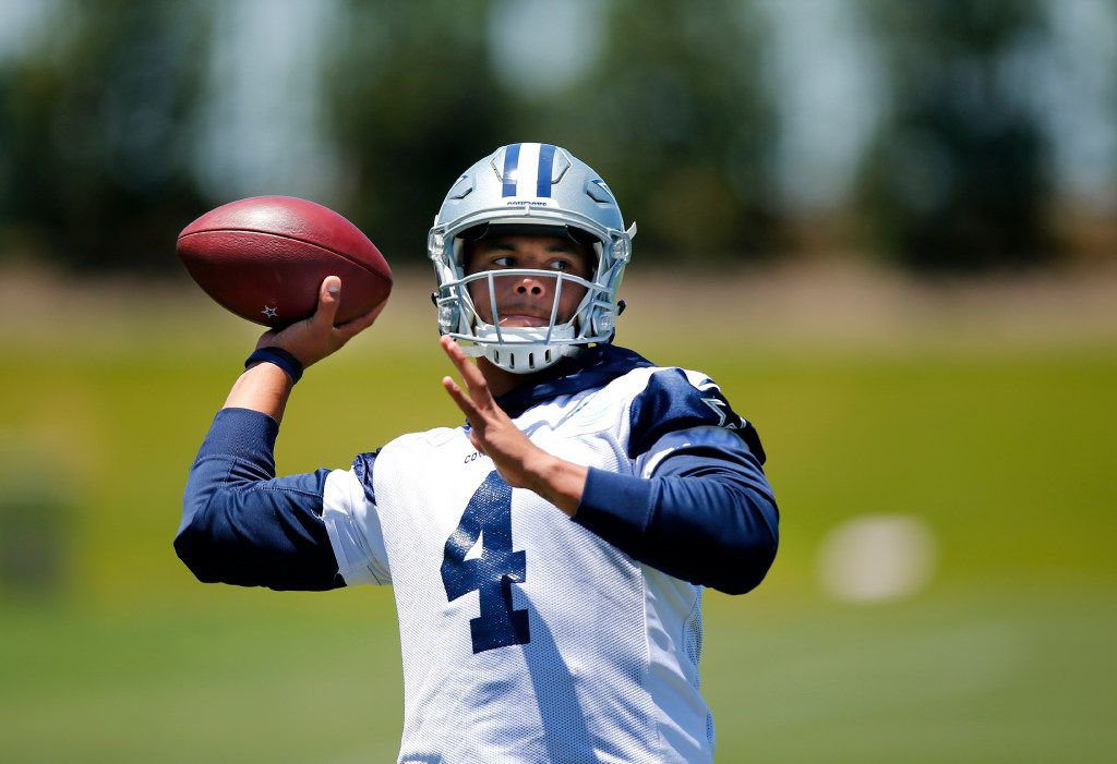 Dallas Cowboys quarterback Dak Prescott (4) throws during an end of organized team activities competition with head coach Jason Garrett (not pictured) at The Star in Frisco, Texas, Wednesday, May 24, 2017. (Tom Fox/The Dallas Morning News)