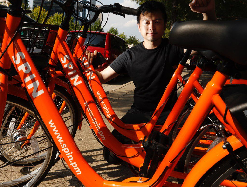 Euwyn Poon, president of Spin, a new bike share company in Dallas, photographed by Klyde Warren Park on Friday August 4, 2017. (Ron Baselice/The Dallas Morning News)