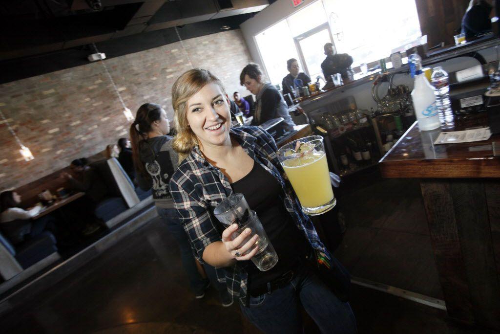 Waitress Mallori Westbrook, 23, carries a mimosa pitcher to a table during brunch at 504 Bar and Grill, on Sunday, Jan. 10, 2016 on Greenville Avenue in Dallas.
