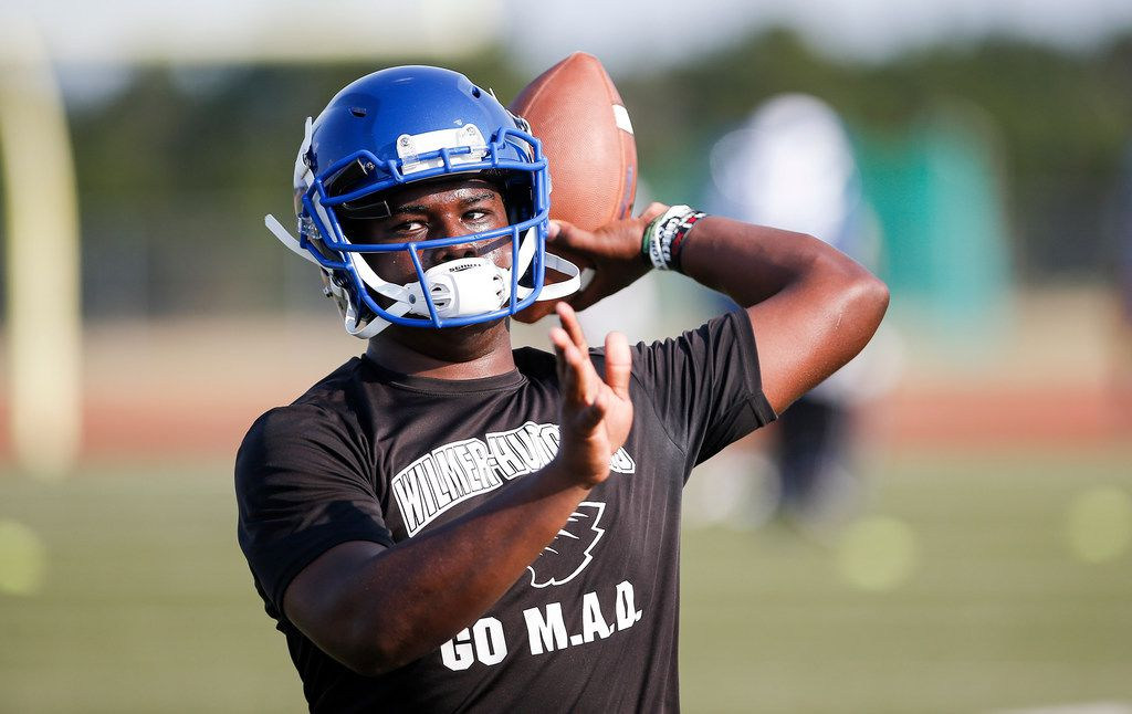 Wilmer-Hutchins senior quarterback Kyle Douglas participates in a drill during the first practice of the season at Wilmer-Hutchins Eagle Stadium in Dallas, Monday, August 5, 2019. (Brandon Wade/Special Contributor)