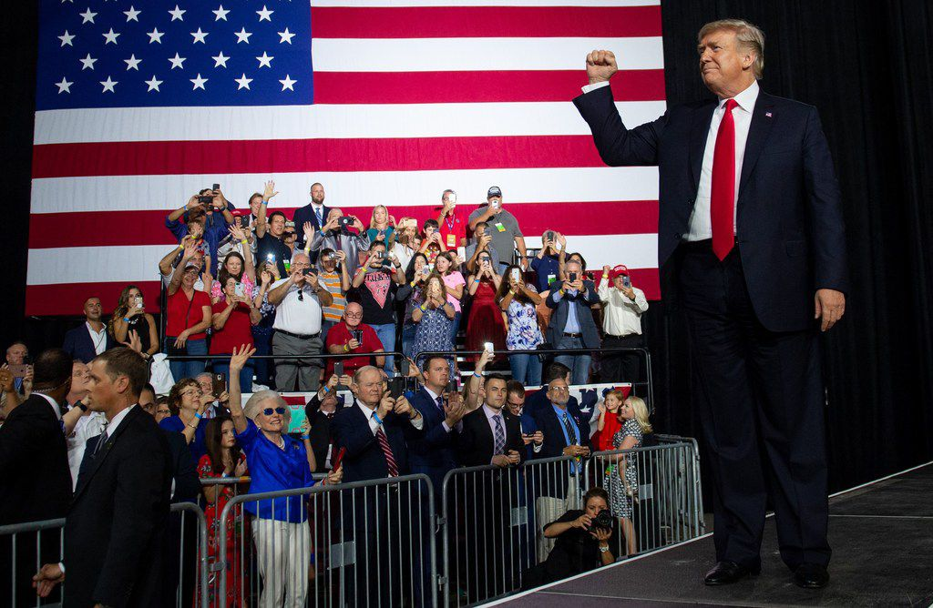 President Donald Trump greets the crowd during a campaign rally at the Florida State Fairgrounds Expo Hall in Tampa, Fla., on Tuesday. His administration rolled out support for short-term health insurance plans on Wednesday.