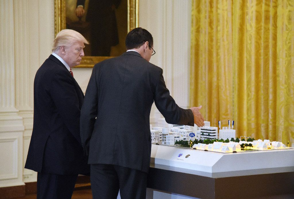 AT&T Senior Executive Randall Stephenson, right, explains to President Donald Trump how 5G will be deployed in cities during the American Leadership in Emerging Technology Event on Thursday, June 22, 2017 in the East Room of the White House in Washington, D.C.