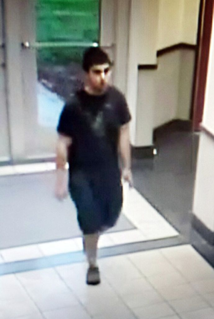 A picture of the suspect entering Cascade Mall