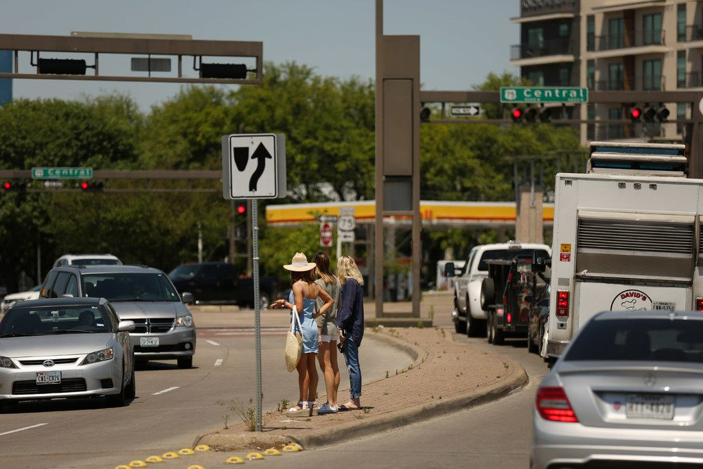 Pedestrians walk along Henderson Avenue near Central Expressway in Dallas Tuesday April 24, 2018. (Andy Jacobsohn/The Dallas Morning News)
