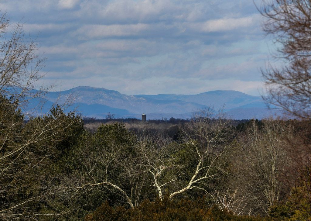 Mountains in Shenandoah National Park are seen in the distance overlooking the property at Woodberry Forest School.
