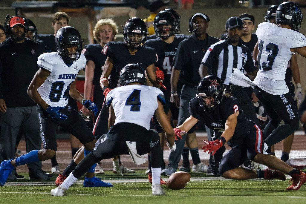 CoppellÕs Jan Rivera (2) and HebronÕs Donovan Tubbs (4) scramble to recover an onside kick during the second half of a high school football game on Friday, Oct. 4, 2019, in Coppell, Texas. (Smiley N. Pool/The Dallas Morning News)
