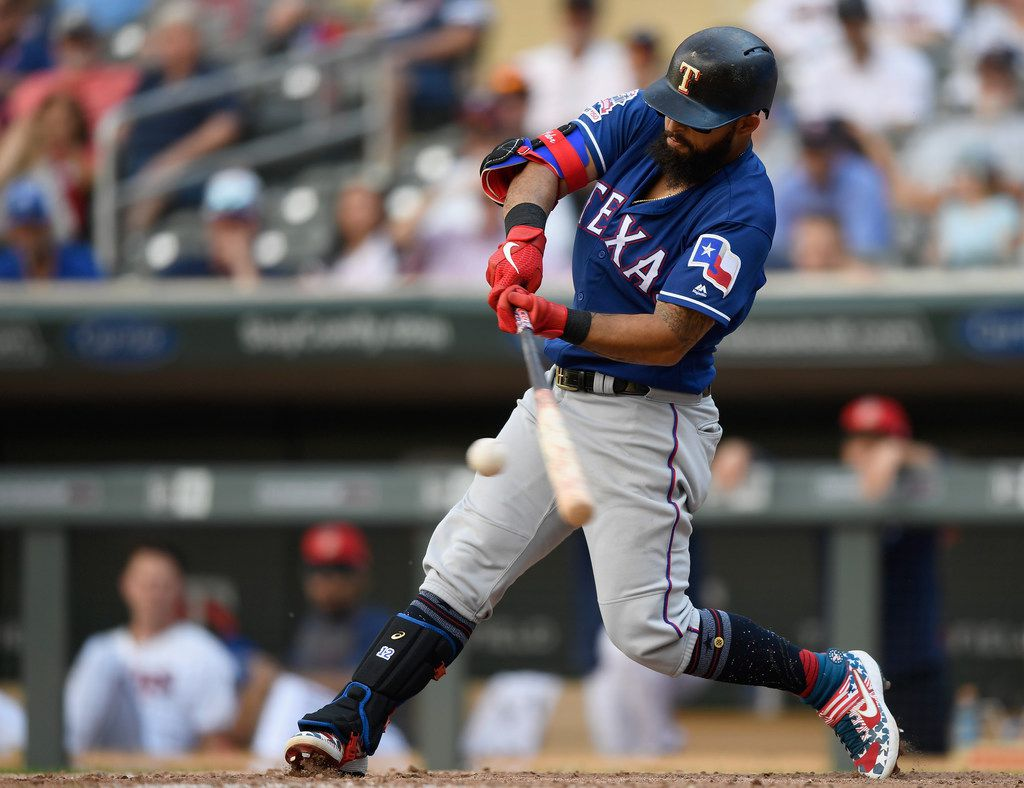 MINNEAPOLIS, MN - JULY 07: Rougned Odor #12 of the Texas Rangers hits a three-run home run against the Minnesota Twins during the eleventh inning of the game on July 7, 2019 at Target Field in Minneapolis, Minnesota. The Rangers defeated the Twins 4-1 in eleven innings. (Photo by Hannah Foslien/Getty Images)