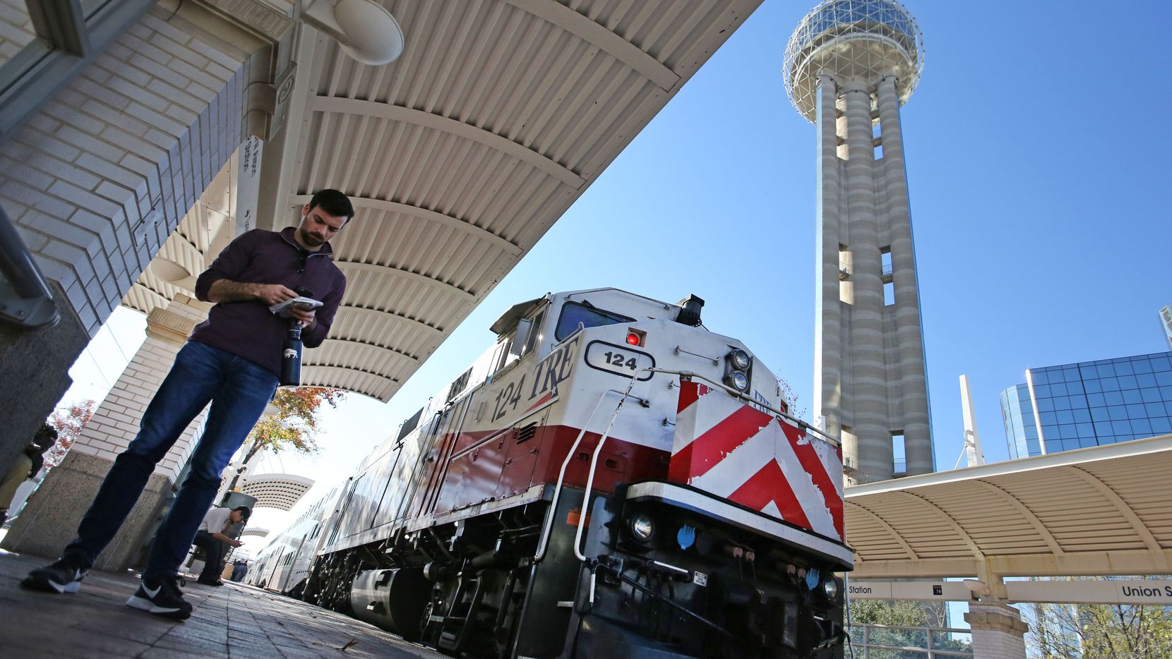 Dallas Morning News reporter Brendan Meyer waits to board the TRE train at Union Station as he takes a mass transit excursion from downtown Dallas to Fort Worth.