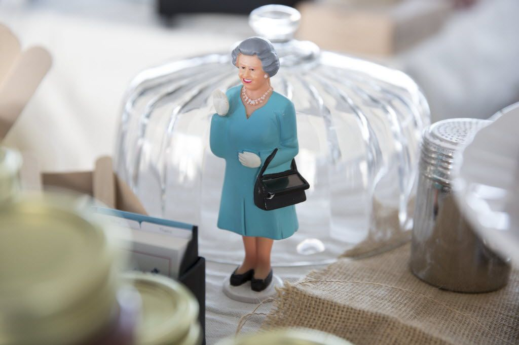 A solar powered Queen of England waves at The Proper Baking Co.'s booth at the Dallas Farmers Market, in Dallas, Texas, Sunday, November 8, 2015. (Allison Slomowitz/ Special Contributor)