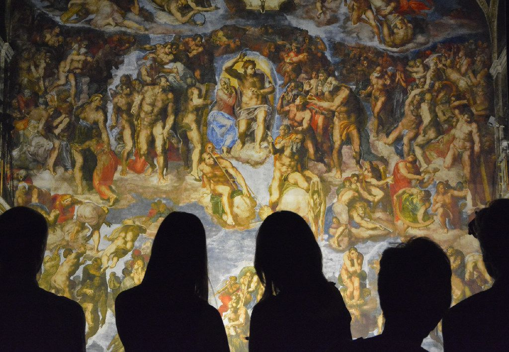 """""""Michelangelo's Sistine Chapel: The Exhibition"""" at the 2016 State Fair of Texas re-creates Michelangelo's renowned ceiling frescoes from the Vatican's Sistine Chapel, reproduced photographically and artfully displayed in their original size."""