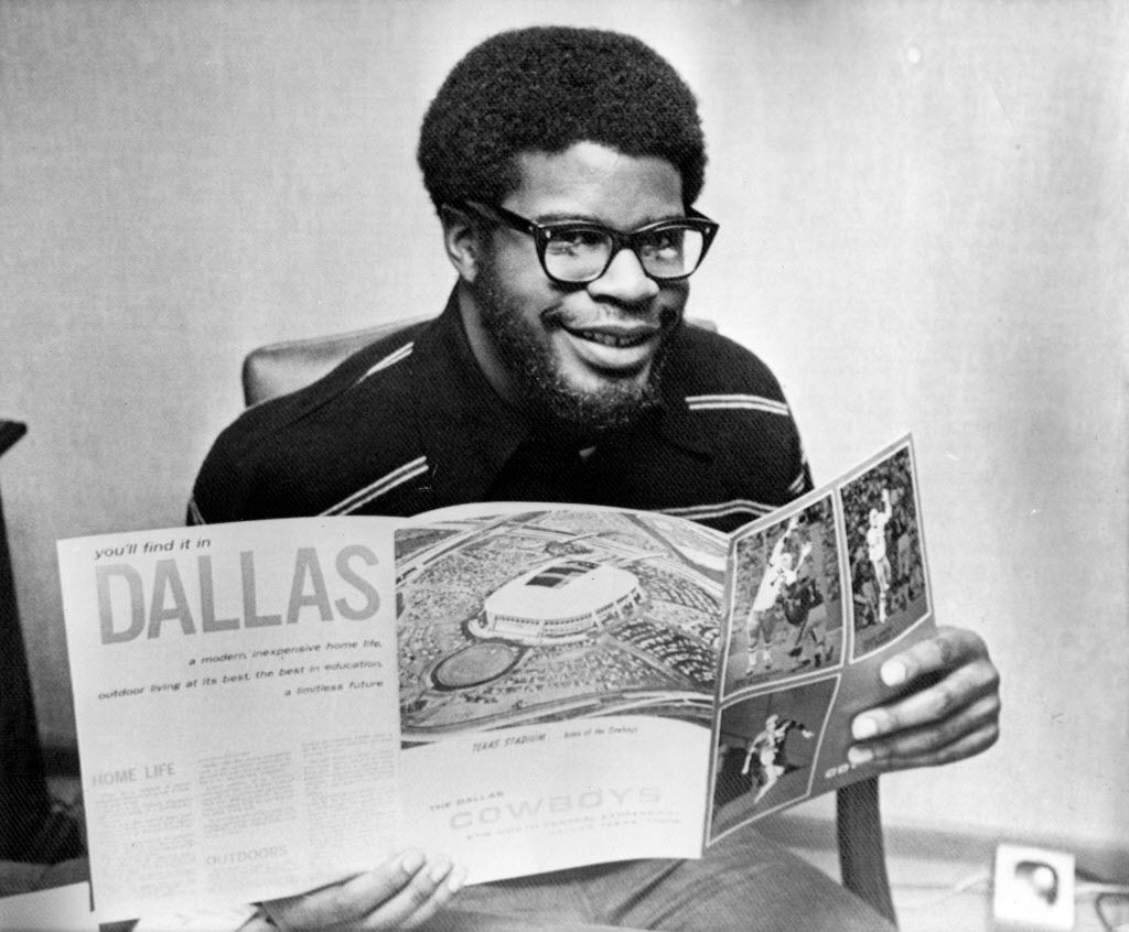 """BOSTON, MA - February 2, 1972 - Bill Thomas, 6' 2"""", 230-pound running back at Boston College, checks through some Dallas Cowboys literature in his dormitory room at Boston College Tuesday afternoon after being picked by the Cowboys as their first round NFL draft choice.  Thomas is a native of Peekskill, New York.  AP Wirephoto"""