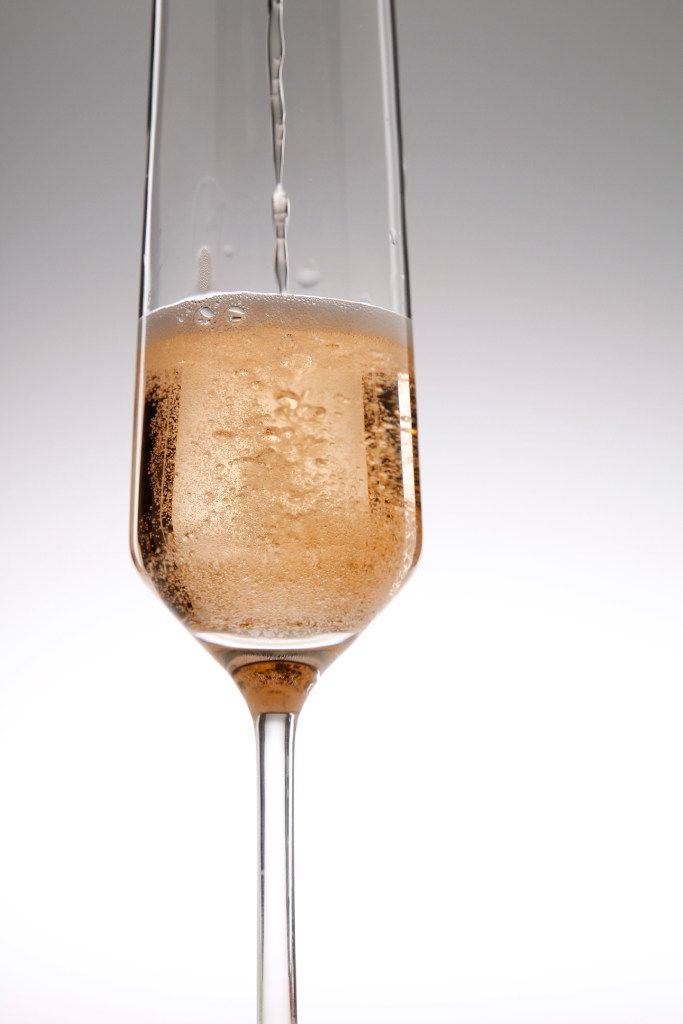 For each glass of bubbly you have, have another glass or two of bubbly (plain is fine, too) water.