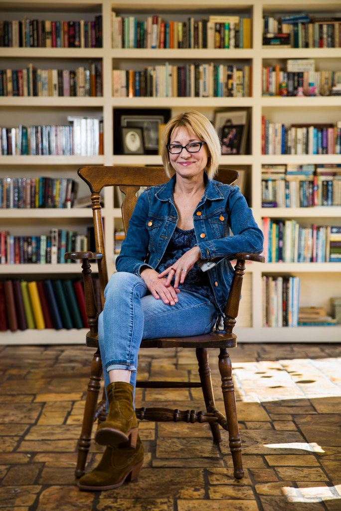 Author Elizabeth Crook poses for a portrait in her living room  in Austin.