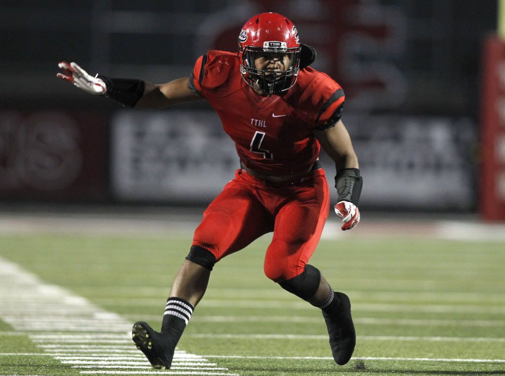 Cedar Hill linebacker Richard Moore (4) pursues on defense in the football game between Arlington Bowie High School and Cedar Hill High School in Cedar Hill, Texas, Saturday, September 6, 2014. Mike Stone/Special Contributor