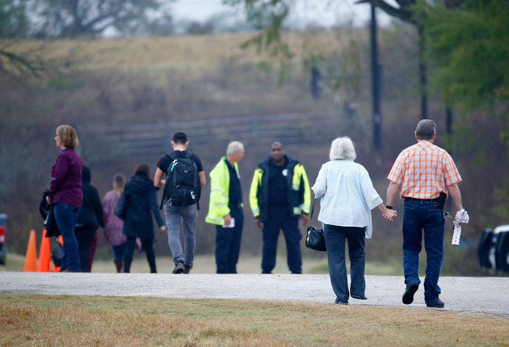People come to the temporary First Baptist Church at a baseball field in Sutherland Springs, Texas on Nov. 12, 2017. The church was the site of a shooting that killed 26 parishioners and left 30 injured.