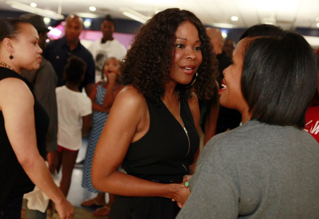 Actress Angela Robinson meets with a fan before the start of the 21st annual Cheryl Smith's Don't Believe the Hype Celebrity Bowl-A-Thon on Saturday at USA Bowl in Dallas.