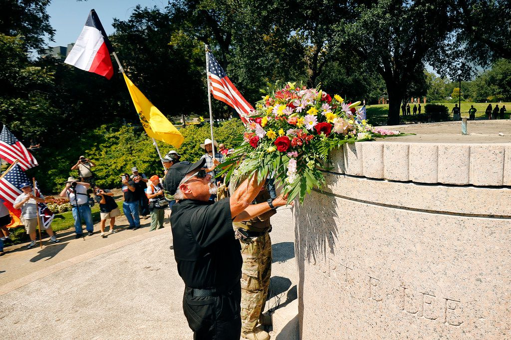 Commanding officer Robert Beverly of the Texas Liberty Coalition places a bouquet of flowers on the Robert E. Lee statue base during This Is Texas Freedom Force protest over removal of the Robert E. Lee statue from Lee Park in Dallas, Saturday, September 16, 2017. (Tom Fox/The Dallas Morning News)