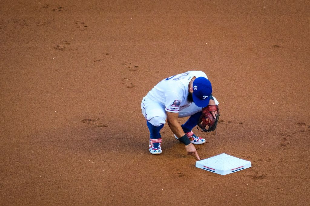 Texas Rangers second baseman Rougned Odor makes the dirt byehind second base before a game against the Tampa Bay Rays at Globe Life Park on Wednesday, Sept. 11, 2019, in Arlington. (Smiley N. Pool/The Dallas Morning News)