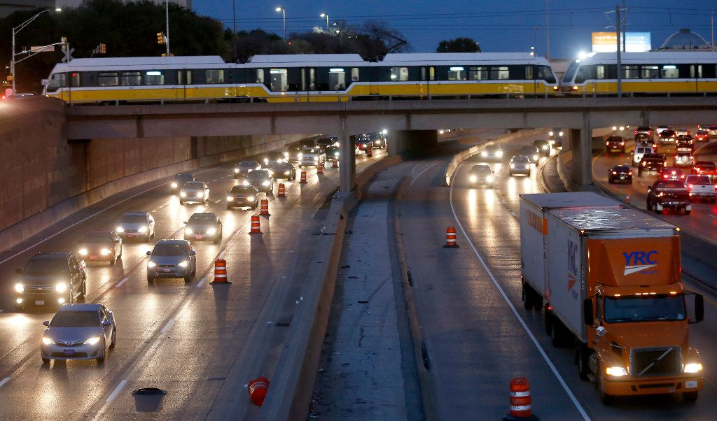Traffic on  Interstate 30 westbound moves near the Interstate 30 and 35E interchange in Dallas, Friday, Feb. 17, 2017.