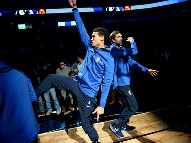 Dallas Mavericks forward Dirk Nowitzki (41) and forward Dwight Powell (7) enter the court before a National Basketball League game between the Golden State Warriors and the Dallas Mavericks at the American Airlines Center in Dallas Wednesday January 3, 2018.
