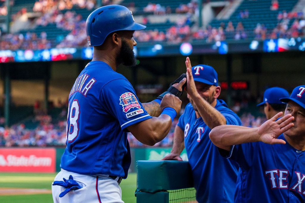 Texas Rangers first baseman Danny Santana celebrates with manager Chris Woodward and bench coach Don Wakamatsu after scoring a run during the first inning against the Seattle Mariners at Globe Life Park on Wednesday, July 31, 2019, in Arlington. (Smiley N. Pool/The Dallas Morning News)