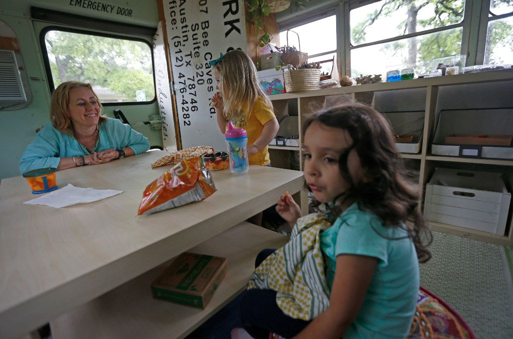 Jennifer Stuart (left) visits with Inez Beltran (right), 3, and Nina Toler-Wells, 2, during a snack time at Seed Preschool. (Jae S. Lee/The Dallas Morning News)