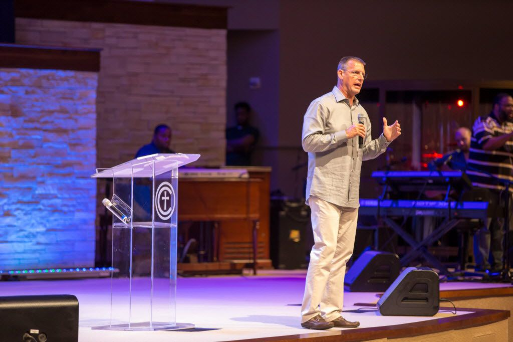 Pastor Todd Wagner of Watermark Church speaks on stage during Together We Stand service at Concord Church on July 8, 2016 in Dallas, Texas. The service was held in response to the killing of 5, and injury of 7 police officers the night before by a gunman at the end of the Black Lives Matter rally held in downtown Dallas.
