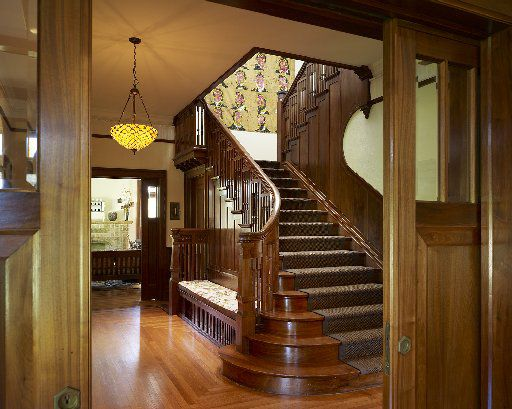 The grand curving walnut staircase in the entry remains a showstopper.