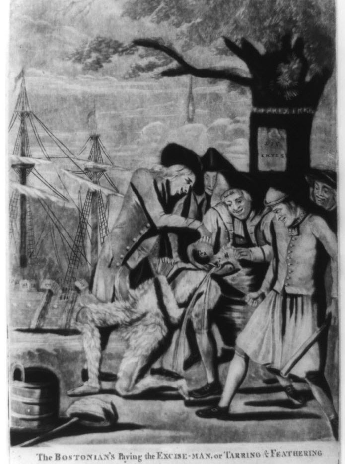 """""""The Bostonian's paying the excise-man, or tarring & feathering:"""" This print from 1774 shows five men forcing a tarred and feathered customs officer to drink from a teapot. A bucket and a liberty cap are on the ground at his feet. They stand beneath the """"Liberty Tree"""" from which a rope with a noose hangs; in the background, shadowy figures on a ship dump tea overboard."""