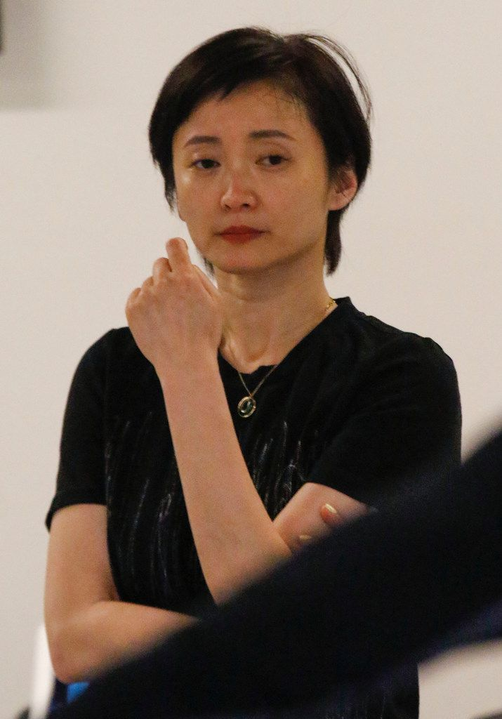 Wang Yuanyuan watches dancers from her Beijing Dance Theater rehearse new works for the TITAS Command Performance gala.