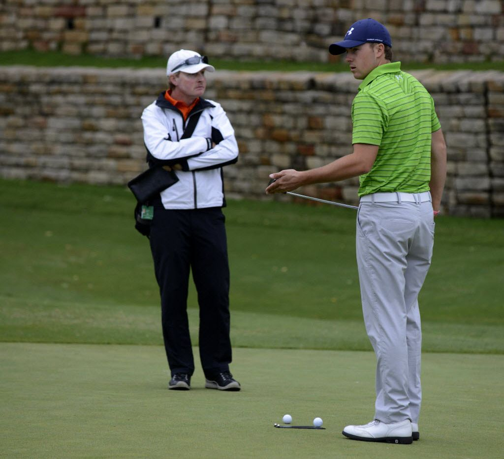 Jordan Spieth warms up with coach Cameron McCormick before teeing off at the Byron Nelson Championship at TPC Four Seasons in Irving on May 15th, 2013.