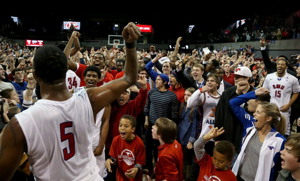 SMU's Markus Kennedy (5) (back to camera, left) cheers as fans storm the court following a 76-55 win against the Cincinnati Bearcats in the American Athletic Conference NCAA Basketball action at Moody Coliseum on the SMU campus in University Park, Texas on Saturday, February 8, 2014.  (Brad Loper/The Dallas Morning News) 02112014xSPORTS 02122014xBRIEFING