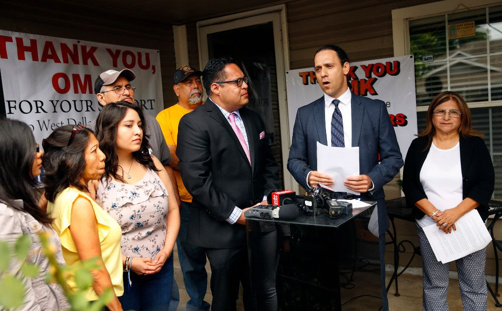 HMK landlord Khraish Khraish (second from right) announced at a press conference that he'd changed his mind and would  to sell homes to their West Dallas tenants for $65,000 in  May 2017.