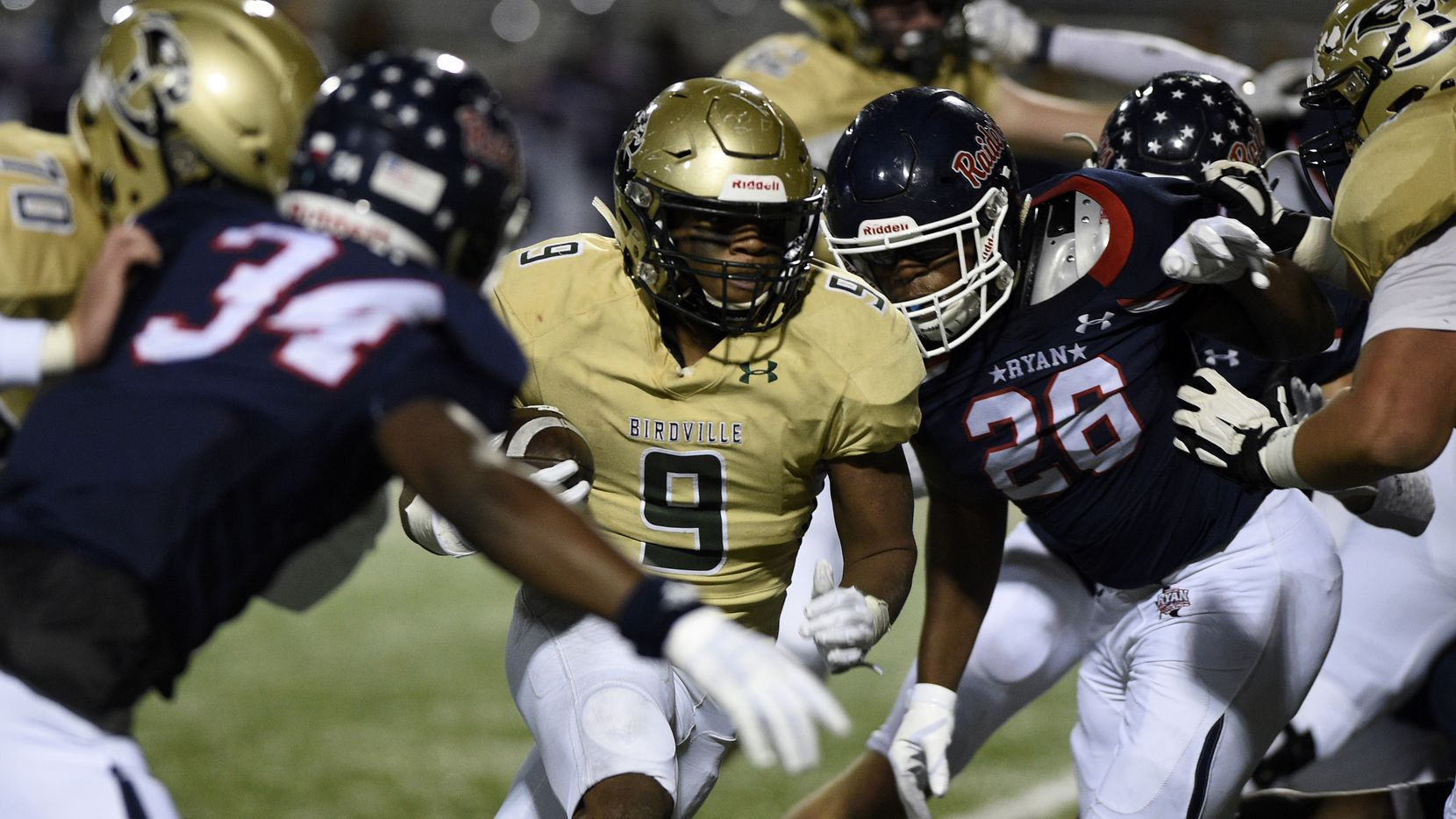 Birdville running back Laderrious Mixon (9) carries the ball against Denton Ryan during the game Thursday at C.H. Collins Athletic Complex in Denton, Texas.