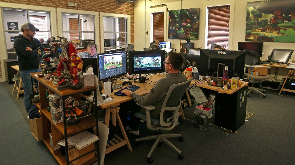 Employees of Playful Corp. are surrounded by action figures at work.