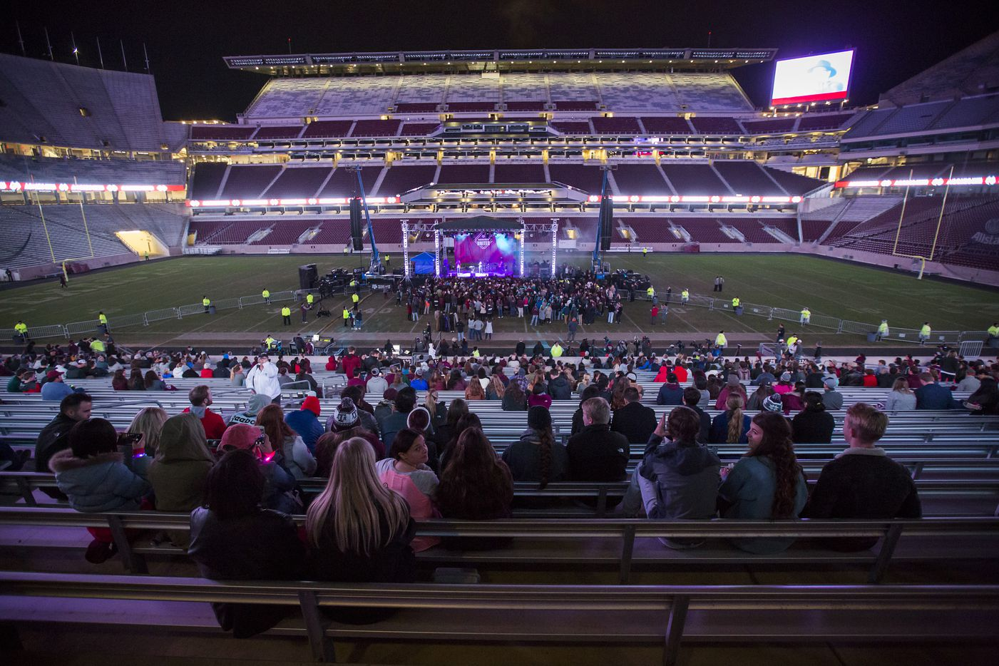 People gather to watch the Bill Clark Trio perform during the Aggies United event at Kyle Field.