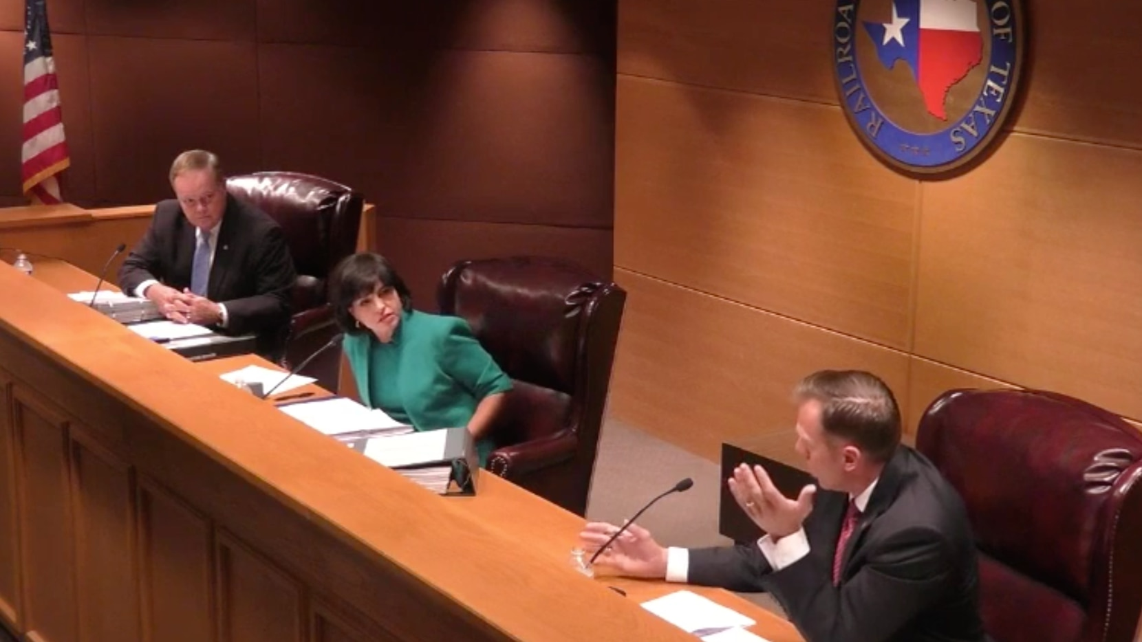 From left: Texas Railroad Commissioner Wayne Christian looks on as fellow Commissioner Ryan Sitton accuses Chairwoman Christi Craddick of acting beyond her authority and violating a law that prohibits backroom decision-making.