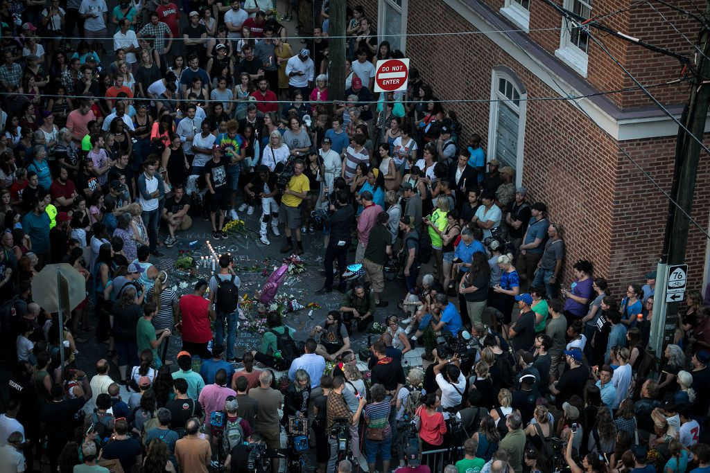 """A vigil at the site where on Saturday a car plowed into a group of counter-protesters after a """"Unite the Right"""" rally by white nationalist groups, in Charlottesville, Va., Aug. 13, 2017. A woman was killed and at least 19 were injured, and the car's alleged driver has been charged with second-degree murder. (Edu Bayer/The New York Times)"""